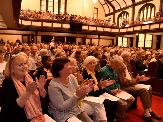 Attendees at the Justice Knox forum applaud  Knox County Sheriff Jimmy JJ Jones and Knoxville Police Chief David Rausch during the Knox Justice forum on Monday night, April 24, 2017, at Central United Methodist Church. (J. Miles Cary/Special to the News Sentinel)