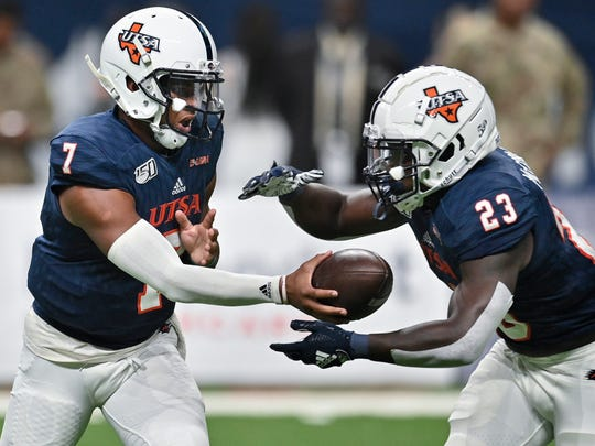 UTSA quarterback Frank Harris (7) hands off to running back Sincere McCormick during the first half of an NCAA college football game against Army, Saturday, Sept. 14, 2019, in San Antonio. (AP Photo/Darren Abate)