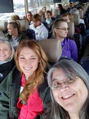 From right: Angela Poirier, Kimba Clunis, and Sheryl Oswalt, with Bus 1.