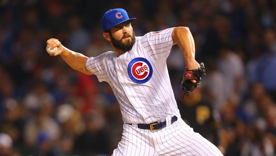 Chicago Cubs starting pitcher Jake Arrieta (49) delivers