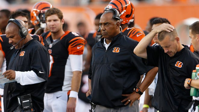 Cincinnati Bengals head coach Marvin Lewis keeps an eye on his team during their preseason game against the Indianapolis Colts at Paul Brown Stadium.  The Enquirer/Gary Landers