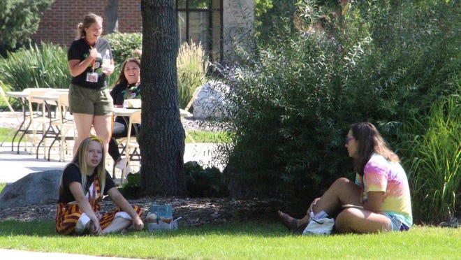 UMN Crookston students chat on the Campus Mall