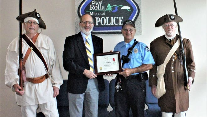 From left, Frank Furman, Kelvin Erickson, officer Larry Seest and Don Turner. The Ozark Patriots chapter of the Sons of the American Revolution presented a Life Saving Award to Seest in September.