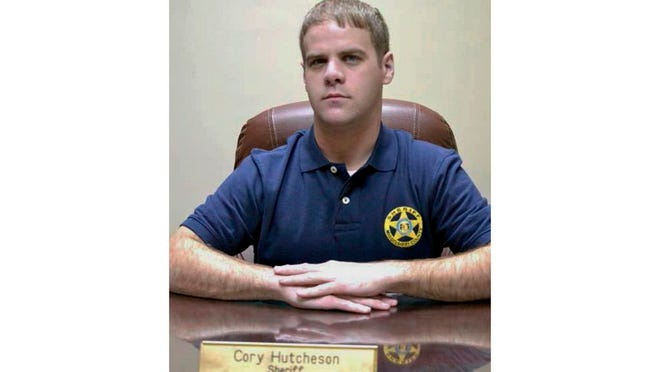 FILE - In this undated file photo, then Mississippi County Sheriff Cory Hutcheson sits behind his desk at the Mississippi County Detention Center in Charleston, Mo. The Missouri NAACP and black lawmakers are calling for a new investigation into the 2017 death of Tory Sanders. Sanders was being held at the Mississippi County Jail, in Charleston, and the sheriff at the time, Hutcheson, was accused of pressing his knee against Sanders' neck for up to three minutes.