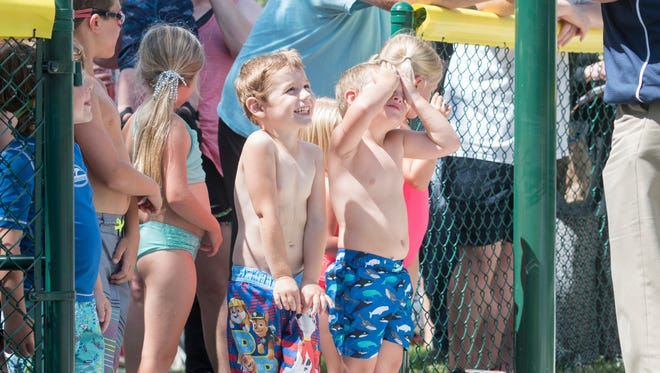 Children anxiously await the end of the ceremony and the actual opening of the new Dolphin Island Splash Pad at Sunset Kids Park in Gulf Breeze on Wednesday.