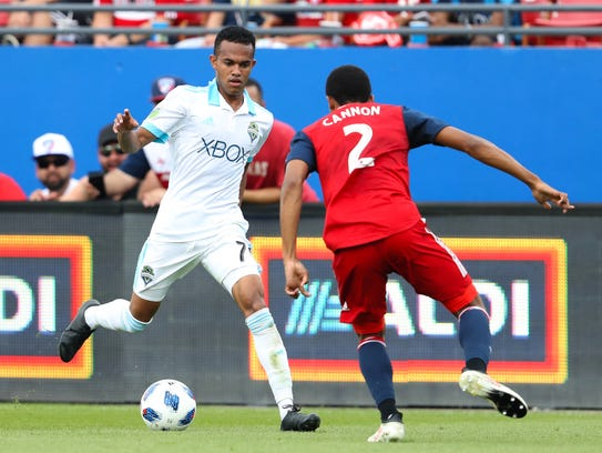 The Seattle Sounders' Handwalla Bwana (70) takes on