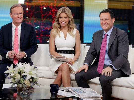 """Brian Kilmeade, right, said on a """"Fox & Friends"""" segment about the freshman Democrat that """"you have to wonder if she's an American first."""""""