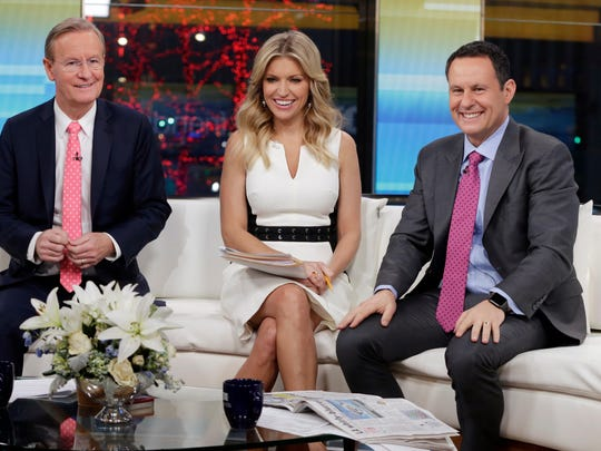 "Brian Kilmeade, right, said on a ""Fox & Friends"" segment about the freshman Democrat that ""you have to wonder if she's an American first."""