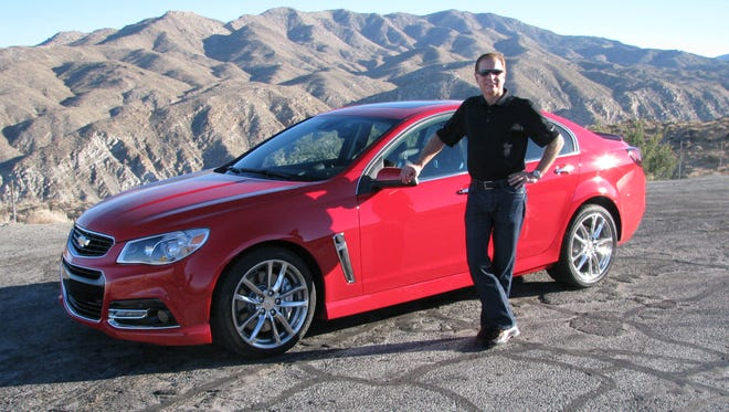 David Leone, executive chief engineer for performance luxury vehicles, shows off the Chevrolet SS