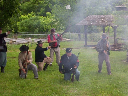 Re-enactors playout a Civil War scene on the grounds of the Wolf House.