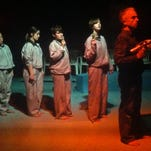 """Isaac Levine, left, and Ada Graham-Lowengard are shown in a scene from Cocoon Theatre's """"The Illustrated Man."""""""
