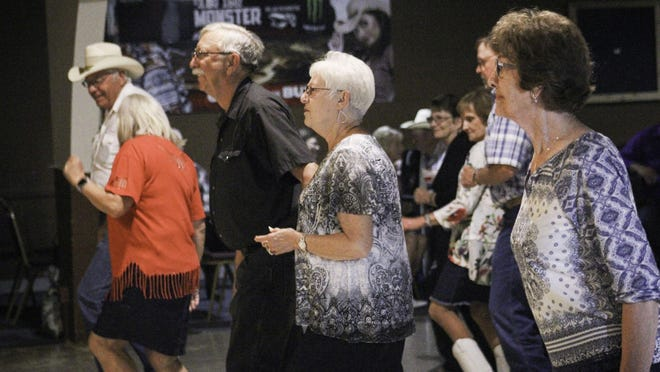 Community members dance to live music for the first time since the COVID-19 outbreak at the Jolly Mixer dance in the Muse Ballroom, 1700 Beverly Drive, in Salina on Wednesday night.