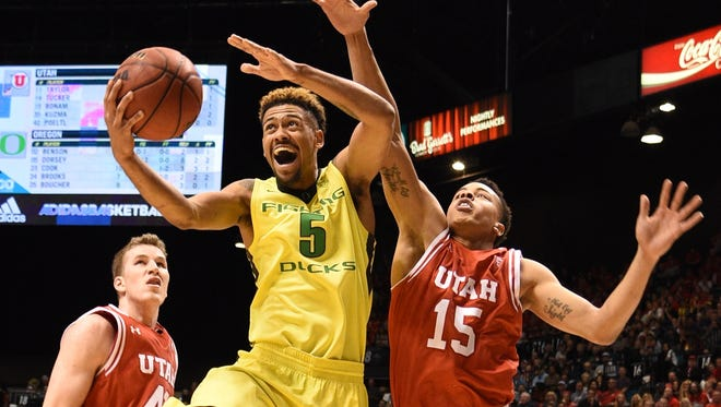 Tyler Dorsey shoots against Utah forward Jakob Poeltl, left, and guard Lorenzo Bonam  during the second half at MGM Grand Garden Arena.