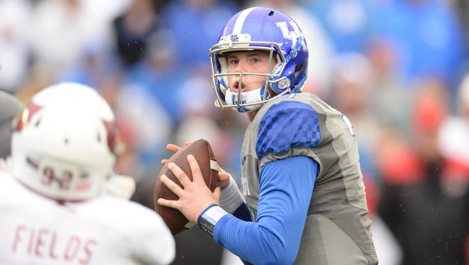 UK QB Drew Barker looks to pass during the University of Kentucky football game against University of Louisville at Commonwealth Stadium in Lexington, Ky., on Saturday, November 28, 2015. Photo by Mike Weaver