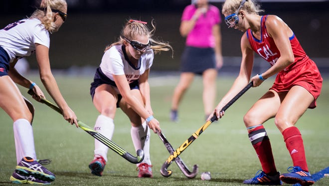 "Sacred Heart Academy's Tori Hill and Amy DiOrio defend against Christian Academy off Louisville's Jacquelyn Wilkins during the Championship Game of the 2017 Apple ""Stick it to Cancer"" Field Hockey Tournament played in Louisville, Ky., Friday, August 25, 2017.  Christian Academy of Louisville defeated Sacred Heart Academy 3-2.  (Photo Bryan Woolston)"