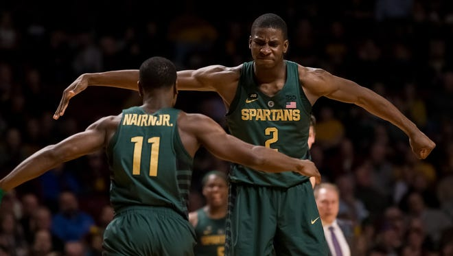 Michigan State Spartans forward Jaren Jackson Jr. (2) celebrates his basket with  guard Lourawls Nairn Jr. (11) in the second half against the Minnesota Gophers at Williams Arena.