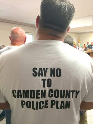 Pennsauken Police Officer Michael Biazzo shows his opinion of potential expansion of Camden County PD to his township.