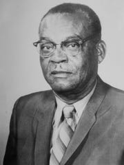 A photo of her late husband Lutrill Payne Amos.
