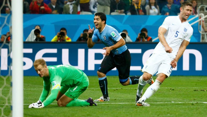 England's Gary Cahill (right) and Joe Hart (left) react as Uruguay's Luis Suarez celebrates his goal during their World Cup Group D match Thursday in Sao Paulo.