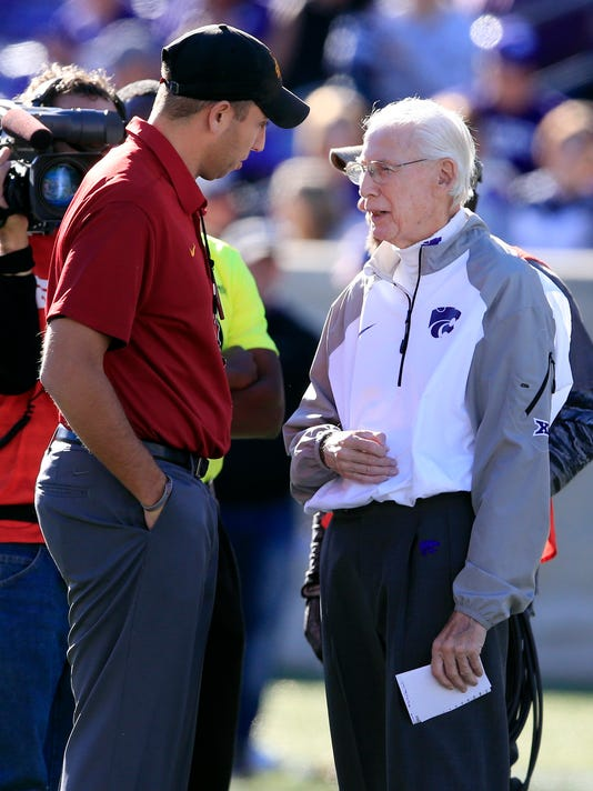 Iowa State head coach Matt Campbell, left, talks with Kansas State head coach Bill Snyder, right, before an NCAA college football game in Manhattan, Kan., Saturday, Nov. 25, 2017. (AP Photo/Orlin Wagner)