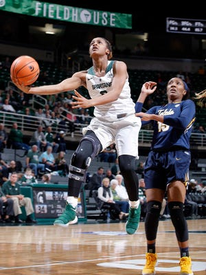 Michigan State's Shay Colley, left, puts up a scoop shot against Toledo's Kaayla McIntyre, Monday, March 19, 2018, in East Lansing, Mich. MSU won 68-66.