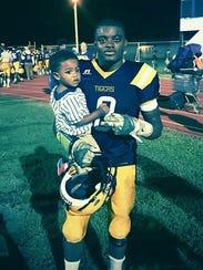 Amik Robertson with his son, Ayden Robertson.