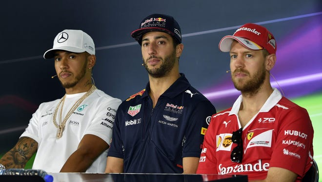 From left to right, Lewis Hamilton, Daniel Ricciardo and Sebastian Vettel discuss their expectations for the new season Thursday in Melbourne, Australia.