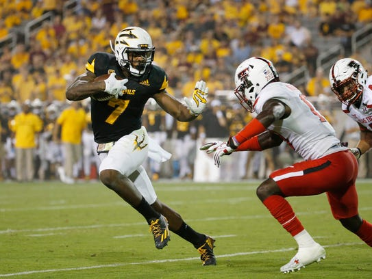 Kalen Ballage beats Texas Tech defensive back Thierry Nguema for one of his NCAA record-tying eight touchdowns in 2016.