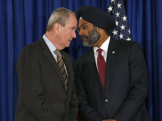 New Jersey Governor Phil Murphy (left) speaks with Attorney General Gurbir S. Grewal during a Tuesday afternoon, February 20, 2018, news conference in Trenton where school security was discussed.