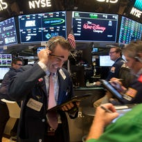 Dow tops 23,000 for first time as stock market rally gains speed