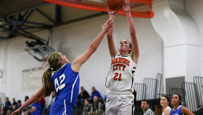 Marine City's Stephanie Abraham takes a shot  during a basketball game.