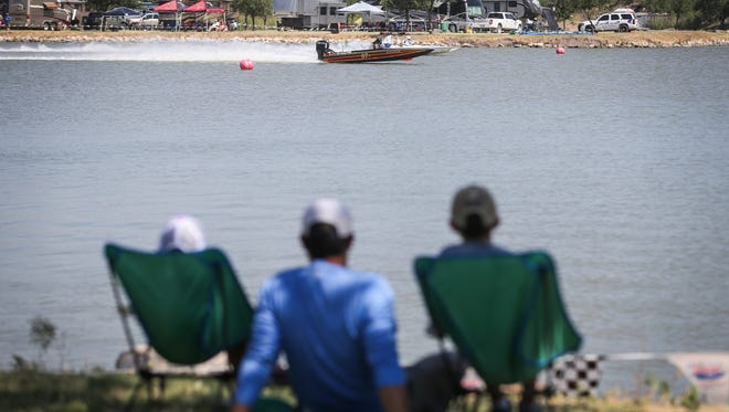 Spectators watch boats race down the course during Showdown in San Angelo Saturday, June 23, 2018 at Spring Creek Park.