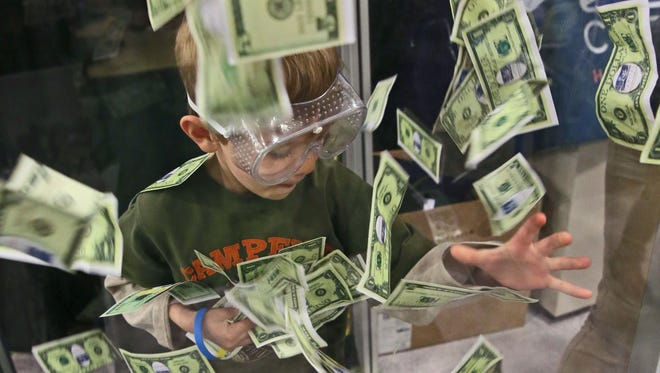 Tyler Repka, 6, of Mukwonago grabbed for play money in a wind-filled glass chamber at an exhibit sponsored by Capital Heating and Cooling at the 2017 Realtors Home & Garden Show. This year's show will take place March 23-25 and 28-31, at the Wisconsin Exposition Center at State Fair Park.
