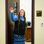Rowan County Clerk Kim Davis, right, goes back to her office after arguing with David Moore and David Ermold, after they were denied a marriage license at the Rowan County Courthouse in Morehead Tuesday morning. (September 1, 2015)