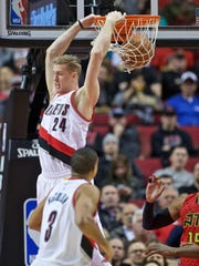 Portland Trail Blazers center Mason Plumlee dunks during the first half of an NBA basketball game against the Atlanta Hawks in Portland, Ore., Wednesday, Jan. 20, 2016. (AP Photo/Craig Mitchelldyer)