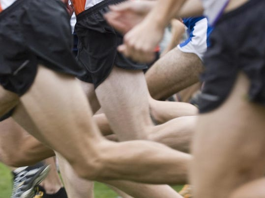 closeup blurred runners legs - male