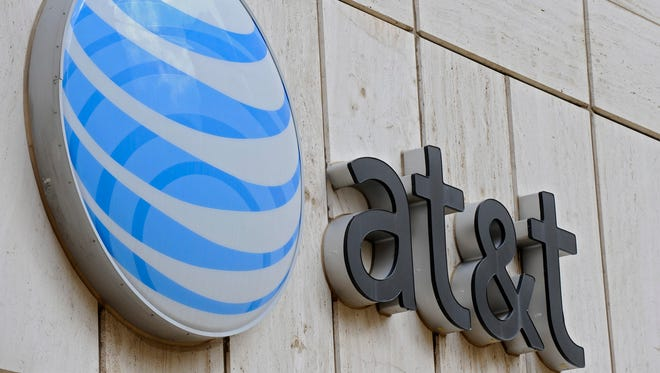 The AT&T logo on the facade of Whitacre Tower, the AT&T global headquarters building at One AT&T Plaza in Dallas, Texas, March 20, 2011.
