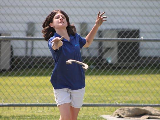 Kayla Bushey throws a horseshoe Sunday while she takes