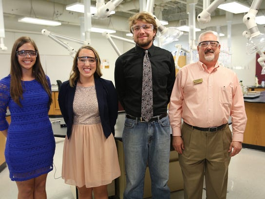 In this 2014 photo, the late chemistry professor Parris Powers, right, poses next to his students in the Vol State chemistry lab, who earned top honors in a student science competition.