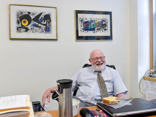 Artwork, case files and lunch items surround Stearns