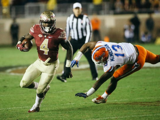 Dalvin Cook (4) runs the ball during the second half