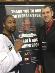 Five Rings Martial Arts owner and operator Stephen Decker, right, has been named to the United States Taekwondo National Coaching pool as a Project Coach for 2016.