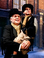 Jared Sakren as Scrooge and Reno Lock as Tiny Tim in a Southwest Shakespeare Company production of 'A Christmas Carol' in 2012.