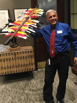 Osceola Grille manager Danny Massoudi was one of many people to pose with this spear at the University Club Center last Friday night. The spear was stolen later in the evening and has not been returned.