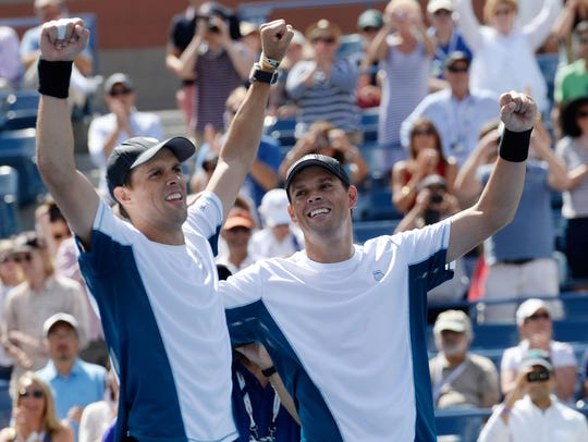 Bob Bryan (right)  and Mike Bryan after beating Marcel