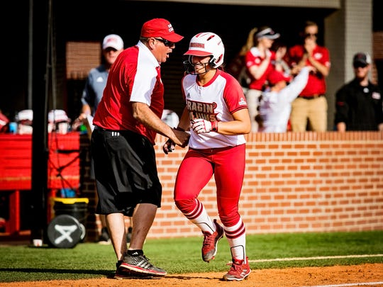 UL coach Gerry Glasco congratulates first baseman Kourtney Gremillion as she rounds third base after hitting a homer against South Alabama at Lamson Park in Lafayette.