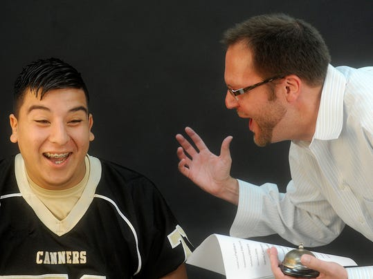 "Biglerville's Victor Lopez reacts as GameTimePA.com assistant sports editor Teddy Feinberg judges a ""name the mascot"" contest at Monday's YAIAA Football Media Day. <a href=""https://www.youtube.com/watch?v=SIueoSRyihs"">Click here to watch video from the contest.</a>"