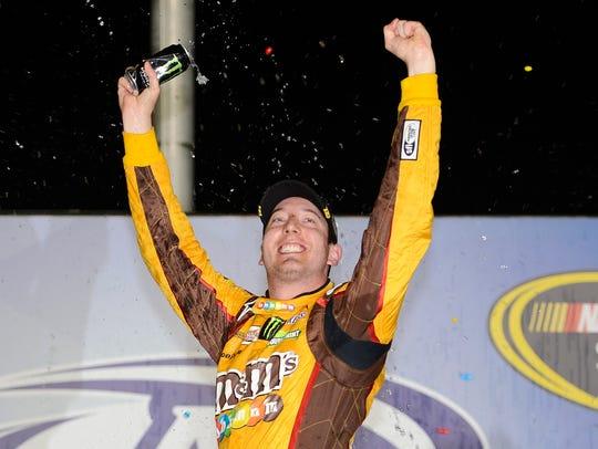 Kyle Busch, shown celebrating a NASCAR win, is headed