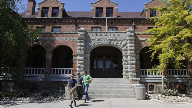 Students walk out of Lincoln Hall, one of two century-old dormitories at the University of Nevada.