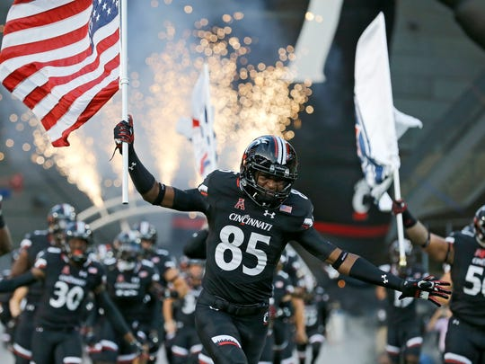 The Cincinnati Bearcats take the field before the first quarter of the NCAA college football game between the Cincinnati Bearcats and the Houston Cougars at Nippert Stadium on the University of Cincinnati campus in Cincinnati on Thursday, Sept. 15, 2016. At the half, the game was tied 10-10.